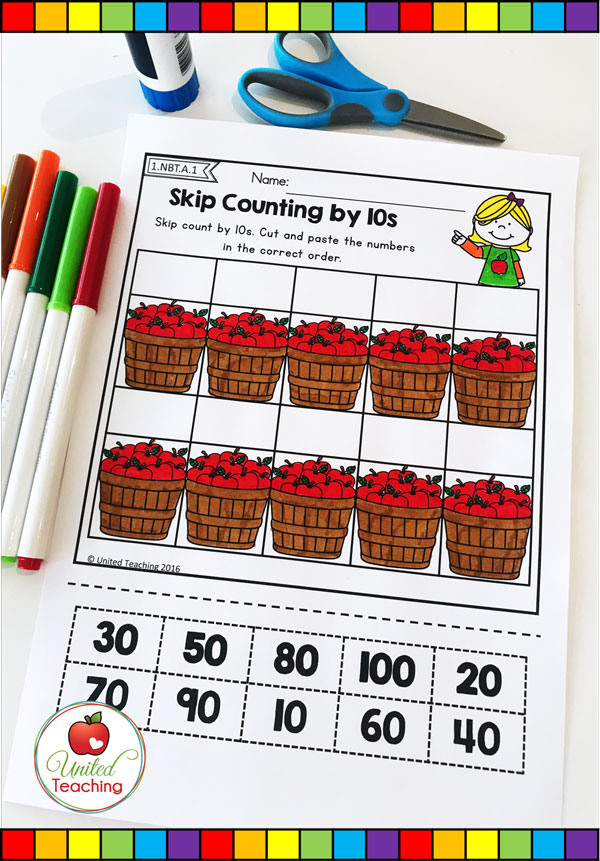 Skip counting by multiples of 10 apple themed math cut and paste worksheet.