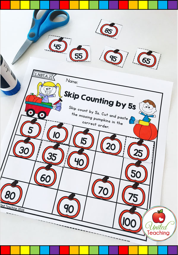 Skip counting by multiples of 5 pumpkin themed math cut and paste worksheet.